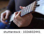 man is playing guitar close up | Shutterstock . vector #1026832441