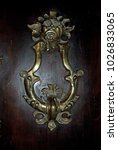 ancient door knocker in italy | Shutterstock . vector #1026833065