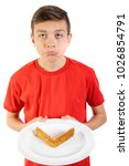 Young caucasian teenage boy doesn't like sandwich crusts - stock photo
