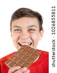 Young caucasian teenage boy and a bar of chocolate - stock photo