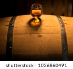 a glass of whiskey sits atop of ... | Shutterstock . vector #1026860491