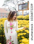 the young girl wear ao dai in... | Shutterstock . vector #1026872239