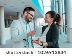smiling coworkers working... | Shutterstock . vector #1026913834