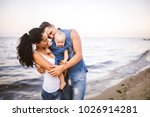 beautiful young family on... | Shutterstock . vector #1026914281