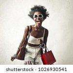 smiling woman doing shopping | Shutterstock . vector #1026930541