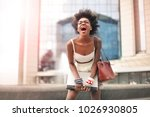 delighted woman laughing | Shutterstock . vector #1026930805