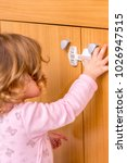 baby girl trying to open the... | Shutterstock . vector #1026947515