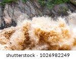 huge waves of muddy waters...   Shutterstock . vector #1026982249
