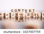 contest word cube on reflection | Shutterstock . vector #1027007755