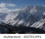 alps mountain range in winter | Shutterstock . vector #1027011991