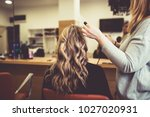 beautiful hairstyle of young... | Shutterstock . vector #1027020931