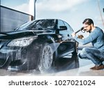 car washing. cleaning car using ... | Shutterstock . vector #1027021024