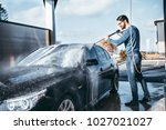 car washing. cleaning car using ... | Shutterstock . vector #1027021027