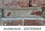 aged red bricks wall  | Shutterstock . vector #1027030069