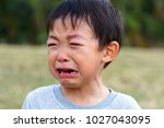 Small photo of Sad expression Asian boy crying