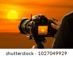 photographers shooting the sun | Shutterstock . vector #1027049929