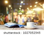coffee cup of coffee with book | Shutterstock . vector #1027052545