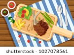 lambchop and salad on wooden... | Shutterstock .eps vector #1027078561