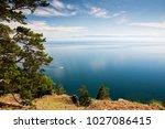 pine tree above lake baikal... | Shutterstock . vector #1027086415