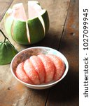 Small photo of Siam Ruby Pomelo on wood.