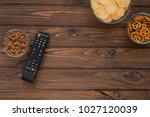 chips  crackers  a remote from... | Shutterstock . vector #1027120039