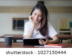 portrait of thai adult student... | Shutterstock . vector #1027150444