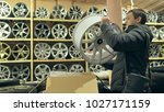 the man buys alloy wheels in... | Shutterstock . vector #1027171159