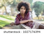 young black female with afro... | Shutterstock . vector #1027176394