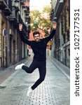 young bearded man jumping in... | Shutterstock . vector #1027177531