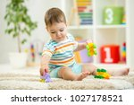 happy child playing with... | Shutterstock . vector #1027178521
