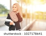 muslimah businesswoman with... | Shutterstock . vector #1027178641