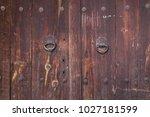 old wood surface  door handle ... | Shutterstock . vector #1027181599