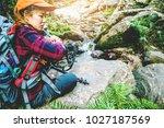 photographer asian women... | Shutterstock . vector #1027187569