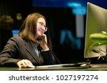 hotel administrator. a woman... | Shutterstock . vector #1027197274