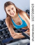 beautiful girl at the gym... | Shutterstock . vector #1027208425