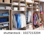 big wardrobe with different... | Shutterstock . vector #1027213204