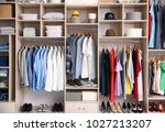 big wardrobe with different... | Shutterstock . vector #1027213207