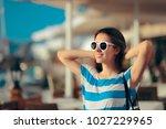 happy travel tourist girl... | Shutterstock . vector #1027229965