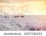 splashes at sea from strong... | Shutterstock . vector #1027236151
