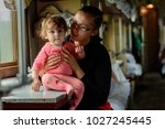 a young mother travels in... | Shutterstock . vector #1027245445