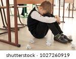 upset little boy sitting on... | Shutterstock . vector #1027260919