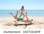 couple running on the beach ... | Shutterstock . vector #1027261849