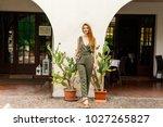 young beautiful girl in green... | Shutterstock . vector #1027265827