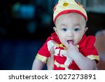 focus cute baby boy wear red...   Shutterstock . vector #1027273891