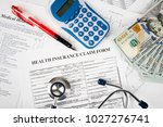stethoscope and calculator... | Shutterstock . vector #1027276741