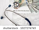 health care costs. stethoscope... | Shutterstock . vector #1027276765