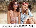 happy mixed race lesbians sit... | Shutterstock . vector #1027281034