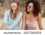good looking two female of... | Shutterstock . vector #1027281055