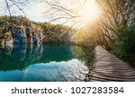 wooden path with natural flare... | Shutterstock . vector #1027283584