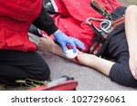 work accident. first aid... | Shutterstock . vector #1027296061